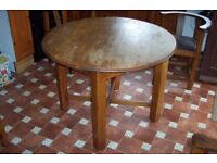 Small round solid oak dining table and 4 matching chairs – unusual design. 50's. £75