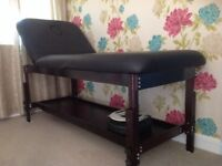 Massage bed with shelf