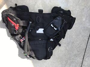 Assorted diving equipment- vest, regulators, fins and bag