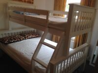 Triple bunk bed, used but in very good condition, with one double memory mattress and one single.