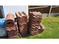 Redland regent rustic red roof tiles for sale.used but excellent condition.
