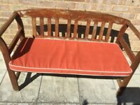 Teak wooden garden bench and rain repellent wipe clean rust cushion
