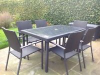 Rattan garden dining set - 6 chairs and table - good condition