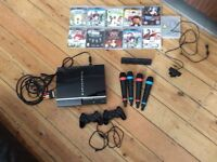 PS3 with 2 remotes and extra PS3 add on's and games!