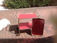 VINTAGE TROLLY AND TRAY ,VERY GOOD CONDITION AND THE TROLLY WHEELS WORK WELL TO .