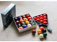 One set each of miniature Snooker balls (Aramith) and American pool (?) balls