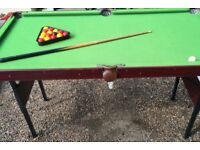Junior snooker / Pool table  Slate based table very good condition both sets of balls
