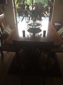 Varnished oak dining table and chairs