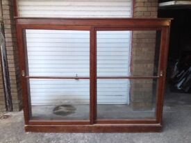 Large cabinet with sliding glass doors....free to collector