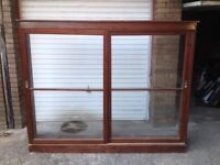 Large cabinet with sliding glass doors.