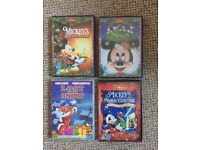 Four Christmas DVDs including Mickey Mouse