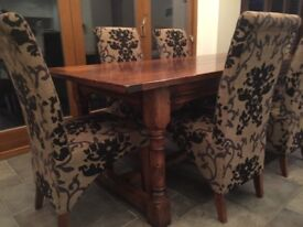 Beautiful dark wood dining table with 6 modern covered chairs