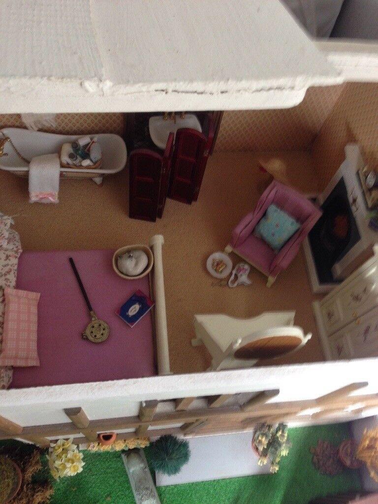 Handmade vintage dolls house - needs some tender loving care. Includes furniture.