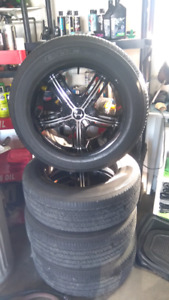 4 Brand new 18 inch  Rims and 4 Used bridgestone tires