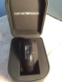 Limited edition Emporio Armani ladies watch in black. With Box. lizard skin