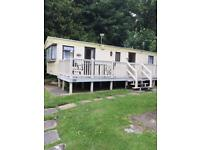 HOBURNE NAISH HOLIDAY PARK. 2 BEDROOM CARAVAN FOR SALE. SITED ON A SECLUDED PLOT.