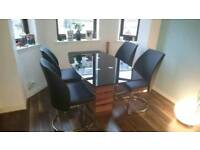 Glass top dining table and matching 4 chairs