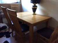 Solid oak dining extending table and 6 chairs