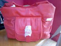 for sale a ladies red handbag