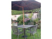 Lightweight metal table, 4 stacking chairs, parasol & base