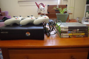 4GB Xbox 360 slim with games + controllers