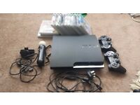 PS3 BLACK SLIM 320GB + PS3 MOVE STARTER PACK + 15 GAMES + 2 GENUINE DUALSHOCK 3 CONTROLLERS