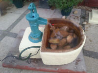 cast iron hand pump water feature with sandstone trough