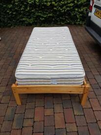 Single wooden bed frame with mattress
