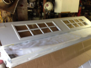 Insulated garage doors with glass. 2- 10x7's (new)