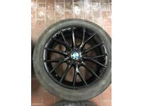 Genuwine 17 inch BMW alloys in black with tyres