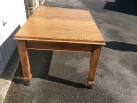 Extending oak dining table and chairs
