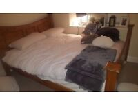 Wooden double bed frame +/- silent night mattress- extremely comfortable.