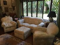 1920/30s Vintage Three Piece Suite with foot stool. Drop arm on sofa and Bun Feet