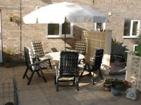 Hartman 5 place setting patio dining set with cushions and parasol