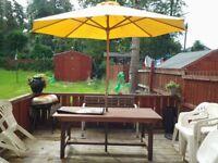 Large wooden table plus large parasol