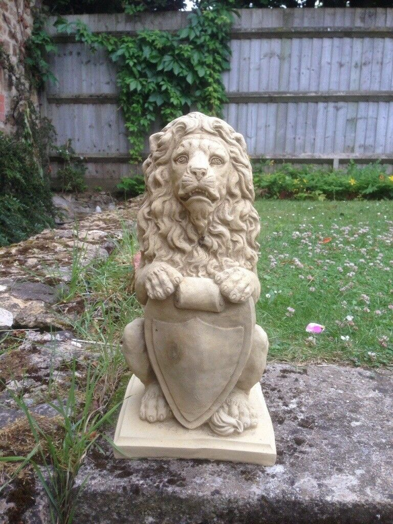 Pair of lions with shields £40