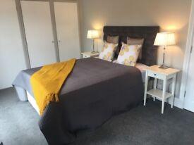 Luxury double bedroom with flat screen TV