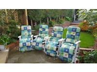 4 heavey duty reclining white plastic garden chairs and cushions
