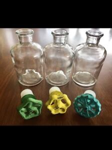 Glass bottles with antiqued tap stoppers
