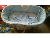 A massive bundle of boys baby clothes. Moses basket and stand. Playmate. Baby bouncer . And more