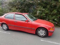 BMW 3 series coupe 3 door in red , read all ad before calling
