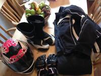Motorcycle clothing, helmet, boots, gloves, trousers, jacket.