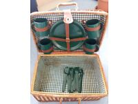 WICKER PICNIC BASKET - 4 CUPS, 4 PLATES & CUTLERY. LINING IS STAINED BUT COULD BE REMOVED.