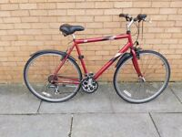 Raleigh hybrid bike with 28 inch wheel size and 22 inch frame