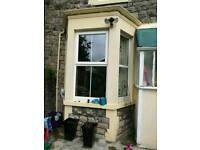 Victorian bay window stone and outbuildings stone