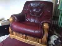 2 leather and oak chairs