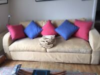 Three seat sofa excellent condition with extra covers.Back arms and legs removable for access