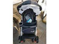 NEW Safety first pushchair suitable from birth with bumper bar, front apron and rain cover.