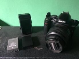 Nikon d3000 + 18-55mm lens + spare battery