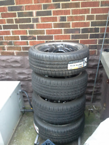 Hercules Raptis tires on rims. Low Profile. UNUSED!!